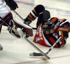 Colin Chaulk is tripped and hits the ice, but is still able to make the backwards pass and get an assist on the team's second goal of the night against the Motor City Mechanics during a 2004-05 regular season game at Memorial Coliseum. (News-Sentinel file photo)
