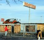 Temporary fencing was being placed around the burned-out shell of the the former Hooters on Coliseum Boulevard. The vacant structure was damaged in a fire Jan. 7.