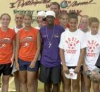 For a small fee, fans could get their picture taken with Major League Soccer star and Fort Wayne native DaMarcus Beasley at the annual AIDSWalk in 2002 at Lawton Park. The Northop High School girls soccer team, shown here, had their picture taken with Beasley prior to the walk.