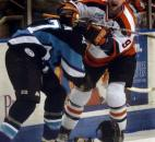 Colin Chaulk and Billy Collins of Muskegon lose their helmets during a scuffle along the boards in April 2005 at Memorial Coliseum. (News-Sentinel file photo)
