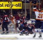 With the puck still spinning in the net, Komets captain Colin Chaulk celebrates his overtime game-winning goal against Rockford at Memorial Coliseum during the 2005 postseason. (News-Sentinel file photo)
