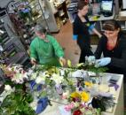 Robin Griswold and Cindy Boneff work on flower arrangements Feb. 13 at Lopshire Flowers & Gifts, 6418 E. State Blvd., as Shenoah White passes behind them. The shop was packed with customers and workers alike the afternoon before Valentine's Day. (Photo by Bob Caylor of The News-Sentinel)