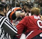 Fort Wayne's Colin Chaulk throws a punch at Kalamazoo's Mike Bickley in a first-period fight during a 2007-08 regular season game at Memorial Coliseum. (News-Sentinel file photo)