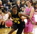 Snider's Deja Wimby, left, makes a move to get around Concordia Lutheran's Olivia Hahn during the first half of the Panthers' 62-52 win Jan. 18 at Concordia. The game was played with a pink basketball, and after the game ball was auctioned off to raise money for cancer research.