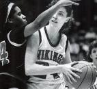 Huntington North's Jennie Folks attempts to drive to the hoop during her team's 1990 semistate victory against LaSalle. Huntington North the following week would beat undefeated Bedford North Lawrence 50-47 in the state finals to capture the program's first state championship. News-Sentinel file photo