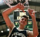 Mark Richardson cuts the net in celebration after Bishop Dwenger defeated North Side 63-61 in the 1994 sectional finals at Memorial Coliseum. With less than three seconds remaining in the game, Richardson hit the game-winning shot to give Bishop Dwenger its third sectional title and first since 1989.