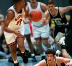 Bishop Dwewnger's Brendan Carretta watches as North Side's Keion Brooks takes off with the ball after knocking it from Carretta during the 1995 sectional finals at Memorial Coliseum. Brooks had 13 points as North Side defeated Bishop Dwenger 76-61 to win the program's third sectional title in four years.