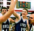 Carroll's Ryan Maifeld, Matt Ogle and coach Rob Irwin celebrate their 1999 Class 3A sectional championship after making a game-winning basket as time expired to defeat Concordia Lutheran 63-61. Ogle tipped in a missed shot for the game-winning basket that gave Carroll its first sectional title since 1985.