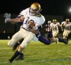 Tyler Eifert avoids Muncie Central's Ben Euliss as he crosses the goal line for Bishop Dwenger's first touchdown in a 26-24 victory against Muncie Central in the 2006 IHSAA regional championship. (News-Sentinel file photo)