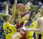 Bishop Luers senior Rachel King goes up for a shot during the 2000 Class 2A state title game against Shenandoah. King finished the season winning The News-Sentinel PrepSports Girls Basketball Player of the Year award and being a first-team All-State selection as she helped the Knights go undefeated and win their third consecutive state title. News-Sentinel file photo