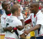 USA's John O'Brien, center, is congratulated by teammates DaMarcus Beasley and Eddie Pope, right, after scoring against Portugal during their Group D, 2002 World Cup match at the Suwon World Cup Stadium in Suwon, South Korea, Wednesday, June 5, 2002.