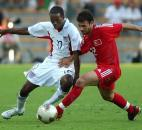 US player Damarcus Beasley, left, fights for the ball with Gokdeniz Karadeniz of Turkey during their Confederations Cup match against Turkey in Saint Etienne, central France, Thursday, June 19, 2003.