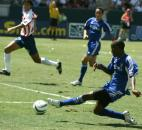 MLS All-Stars' DaMarcus Beasley, right, of the Chicago Fire, scores against the Chivas de Guadalajara in Carson, Calif., Sunday, Aug. 2, 2003. The MLS All-Stars won, 3-1.