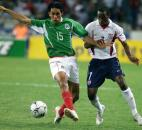 United States player DaMarcus Beasley, right, figth for the ball against Mexico ASCIICHAR_b4 s Amauri Ponce during their semifinal Pre-Olympic U23 soccer match celebrated at the Jalisco Stadium Tuesday, Feb. 10, 2004, in Guadalajara City, Mexico.