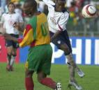 The United States DaMarcus Beasley, right, shoots past Grenada's Franklyn Baptiste during the CONCACAF World Cup qualifying match on Sunday, June 20, 2004, at the National Stadium in St. George's, Grenada. The U.S. won 3-2.
