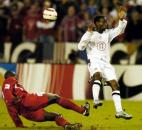The United States' DaMarcus Beasley (17), who plays for PSV Eindhoven in the Netherlands, battles for the ball against Panama's Jose Anthony Torres, left, during the second half of their World Cup qualifying match Wednesday, Oct. 13, 2004, at RFK Stadium in Washington. The US won 6-0.