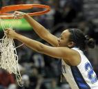 Canterbury's Paige Wells cuts down the net after the team defeated Vincennes Rivet in overtime 72-66 in the 2009 Class A state finals at Memorial Coliseum. The Cavaliers rallied from a nine-point deficit in the final five minutes of regulation to force overtime and eventually repeat as state champions. Photo by Ellie Bogue