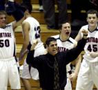 Coach Chris Hissong and several Heritage players celebrate teammate Ryan Axt's buzzer-beating tip-in as the Patriots knocked off Angola 45-44 in the first round of the 2009 Class 3A sectional. Heritage would lose in the sectional semifinals to Bishop Dwenger to end its season.