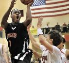 Bishop Luers' Deshaun Thomas scores against Bluffton in the 2010 Class 2A sectional. In his senior season, Thomas would be named Mr. Basketball after leading defending state champion Bishop Luers to a sectional and regional title before being upset in the semistate.