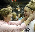 Assistant coach Cathy Pusey congratulates Erynn Meiklejohn after Concordia Lutheran beat Rushville 59-48 in the 2010 Class 3A state finals at Memorial Coliseum. Meiklejohn in the victory led all players with 16 points as Concordia won its first state championship in program history. Photo by Ellie Bogue