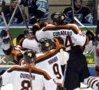 Teammates mob Colin Chaulk after he scored an overtime game-winning goal for the Komets against Muskegon in the 2008 postseason. (File photo by Ellie Bogue of The News-Sentinel)