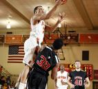 Northrop's Bryson Scott, left, leaps to take a shot in the third quarter of the Bruins' 95-59 win over Bishop Luers on Jan. 11 at Northrop.