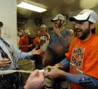 Colin Chaulk, right, sprays champagne in the Komets locker room after winning the 2008 Turner Cup. (News-Sentinel file photo)