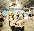 Homestead's 200-yard freestyle relay team hugs before the start of their heat race in the IHSAA state preliminaries Feb. 8 at the IUPUI Natatorium. (Photo by Chad Ryan/INMedia Source)