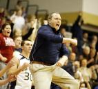 Norwell coach Randy Hawkins jumps and cheers after the basket that brought his Knights back to tie Wayne late in the fourth quarter after trailing by as much as 20 points in the game Jan. 9 at Norwell. The Knights, who never led in regulation time, surged in the overtime period to beat Wayne 85-80.