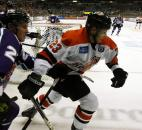 Eric Giosa, right, skates out of the grasp of Orlando's Sean Lorenz behind the Solar Bears' net in the third period of the Komets' 3-2 win Jan. 5 at Memorial Coliseum.
