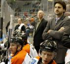As a player/assistant coach, Colin Chaulk, right, coaches from behind the Komets' bench Jan. 6 at Memorial Coliseum. Chaulk was sidelined by an infection on his foot and coached until he was cleared to play.