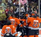 The Komets mob Colin Chaulk after his game-winning overtime goal against the Rapid City Rush during the 2012 Turner Conference semifinals. The Komets won 4-3 to win the series in six games. (News-Sentinel file photo)