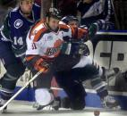 Komets center Colin Chaulk is knocked off his feet by Missouri River Otters players Joe Ritson and Dustin Whitecotton during a game in January 2003 at Memorial Coliseum. (News-Sentinel file photo)