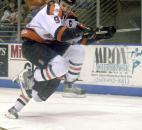 Komets forward Colin Chaulk leaps a poke-check attempt and keeps his eye on the puck during the second period of the Komets' first-round playoff game against Port Huron in April 2003. (File photo by Ellie Bogue of The News-Sentinel)