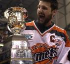 Captain Colin Chaulk accepts the Colonial Cup for the Komets in 2003. The Komets beat the Quad City Mallards to win the 2003 UHL championship. (News-Sentinel file photo)