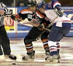 The Komets' Colin Chaulk and the Stars' B.J. Kilbourne battle for control of the puck in the second period of a 2003 game at the coliseum. (File photo by Ellie Bogue of The News-Sentinel)