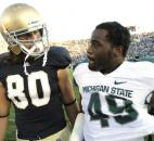 Notre Dame's Tyler Eifert and Michigan State's TyQuan Hammock meet up on the field after their game in 2011. The two players were rivals at college afer being rivals at the high school level in Fort Wayne, with Eifert coming from Bishop Dwenger and Hammock coming from Bishop Luers. (News-Sentinel file photo)