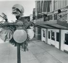 Christmas decorations still hang on two lamp poles outside the Baker Street Station on March, 11, 1987. (Photo by The News-Sentinel)