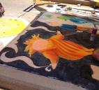"Madison Aschliman, an artist at the Fort Wayne Museum of Art's Chalk Walk at the Fort Wayne Newspapers Three Rivers Festival and junior at Snider High School, based her design upon the movie ""Rise of the Guardians"". (Photo by Jaclyn Goldsborough of The News-Sentinel)"