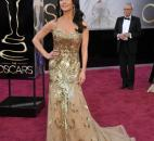 Catherine Zeta-Jones wore an  all-gold Zuhair Muhad gown. (From The Associated Press)