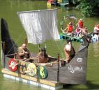A Viking-style raft makes it way down the St. Marys River Saturday afternoon as part of the Fort Wayne Newspapers Three Rivers Festival Raft Race. Photo by Matthew Glowicki of The News-Sentinel