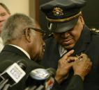Jan. 2, Pastor Sam Shade Jr. of Pilgrim Baptist Church  pinned on Police Chief Gary Hamilton's badge of office Jan.1,  after he took the oath from Sandy Kennedy, city clerk,  in the City Council Chambers at Citizen's Square. (Photo by Ellie Bogue of The News-Sentinel).