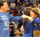 Darby Maggard gets a hug from her mother Deedee Maggard and a pat on the back from her dad, James Maggard after she won the Patricia Roy Mental Attitude Award, Saturday after the Girls Class 2A basketball game.