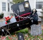 One of several coffins scattered among the Halloween decorations in the 600 block of Third Street.