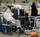 Tired out from the first morning of the  Old Fort Cluster Dog Shows a woman dozes in her chair around noon Wednesday.