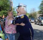 Tracey Graham of Hoagland hugs Admiral Andy as he walks by in the Lutheran Health Network Three Rivers Festival Parade Saturday, July 13. (Photo by Jaclyn Goldsborough)
