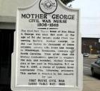 At the 300 block of East Berry St., a plaque locates Eliza George's former Fort Wayne home.