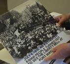"Walter ""Skip"" Sassmannshausen holds a photo submitted by a local resident that shows a thousand people gathering at the Baker Street Station, formally known as the Pennsylvania Railroad Station. (Photo by Jaclyn Goldsborough of The News-Sentinel)"