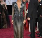 Actress Halle Berry, who was dressed by Donatella Versace, wore a silver beaded-and-black gown with long sleeves and V neck. (From The Associated Press)