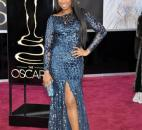 Jennifer Hudson wore a shiny, second-skin blue Roberto Cavalli gown, which almost looked like an animal print. (From The Associated Press)
